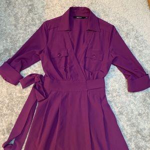 Purple wrap dress.
